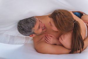 man who takes Progentra in bed with younger woman