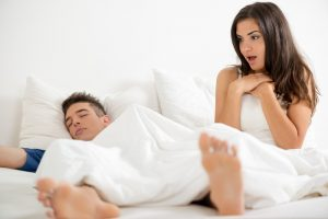 woman looking surprised at morning erection of man