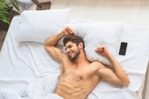 man waking up from a good night sleep has been taking Progentra