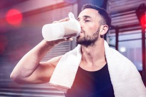 drinking protein supplement before workout