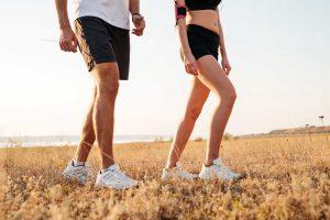 fit couple brisk walking