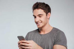 man eagerly texting